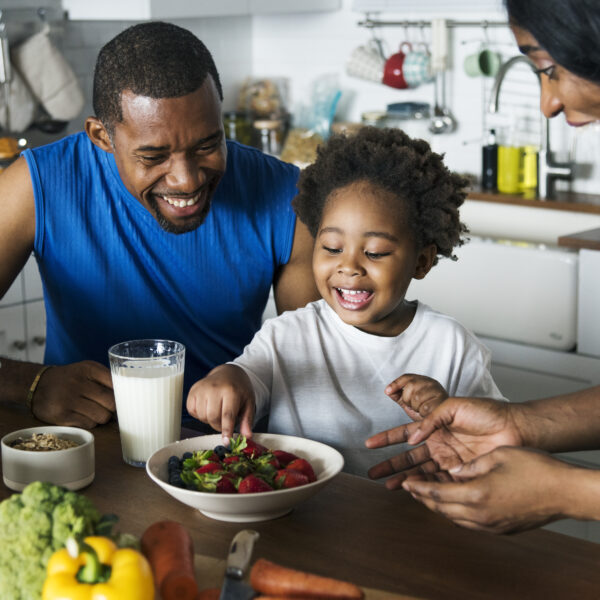 black-nuclear-family-eating-healthy-food-together