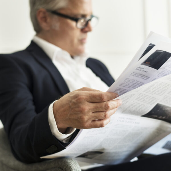 businessman-reading-the-news-from-the-media