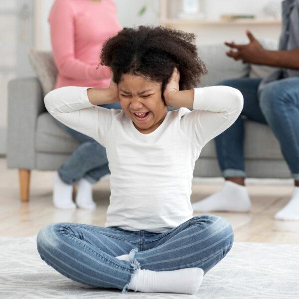 childhood-trauma-little-black-girl-covering-ears