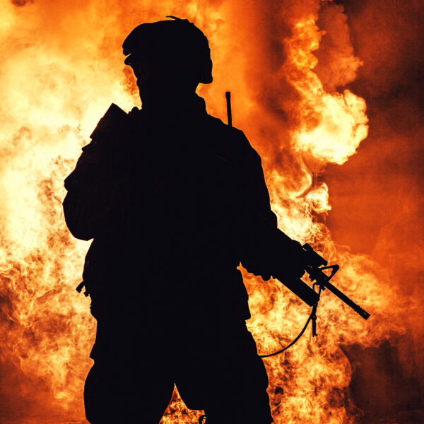 Israel-soldier-silhouette-on-background-of-fire-explosion