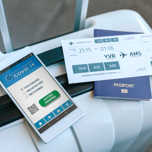 suitcase-with-passport-boarding-pass-and-covid-passport
