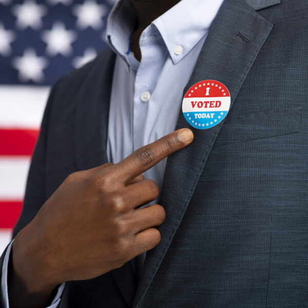 african-american-us-resident-showing-with-finger-on-vote-sticker