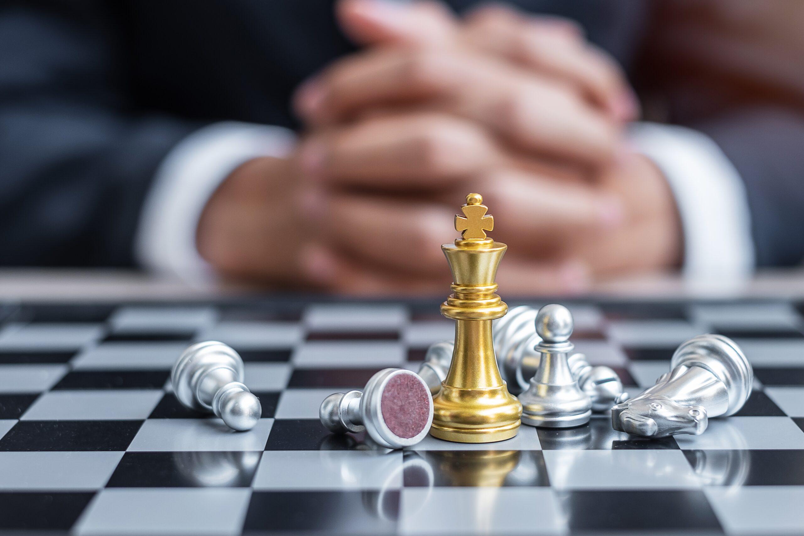 chess-king-figure-against-chessboard-opponent