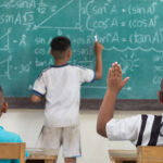 raised-hands-in-classroom-at-country-school