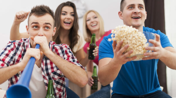 young-group-of-people-celebrating-win-of-favourite-team