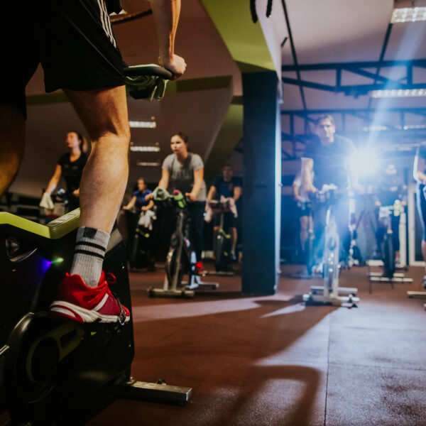 cycling-class-group-indoors-using-peloton