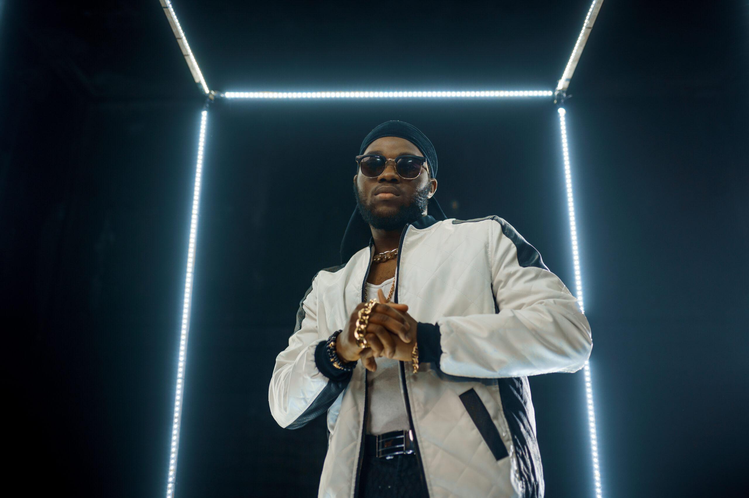 stylish-hip-hop-rapper-in-sunglasses-dark-background