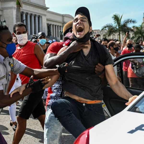 cuban-attacked-by-police