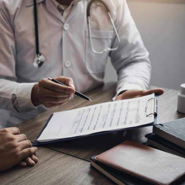 doctor-is-writing-the-appointment-letter-to-the-patient