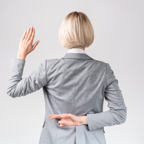female-politician-swearing-oath-with-fingers-crossed
