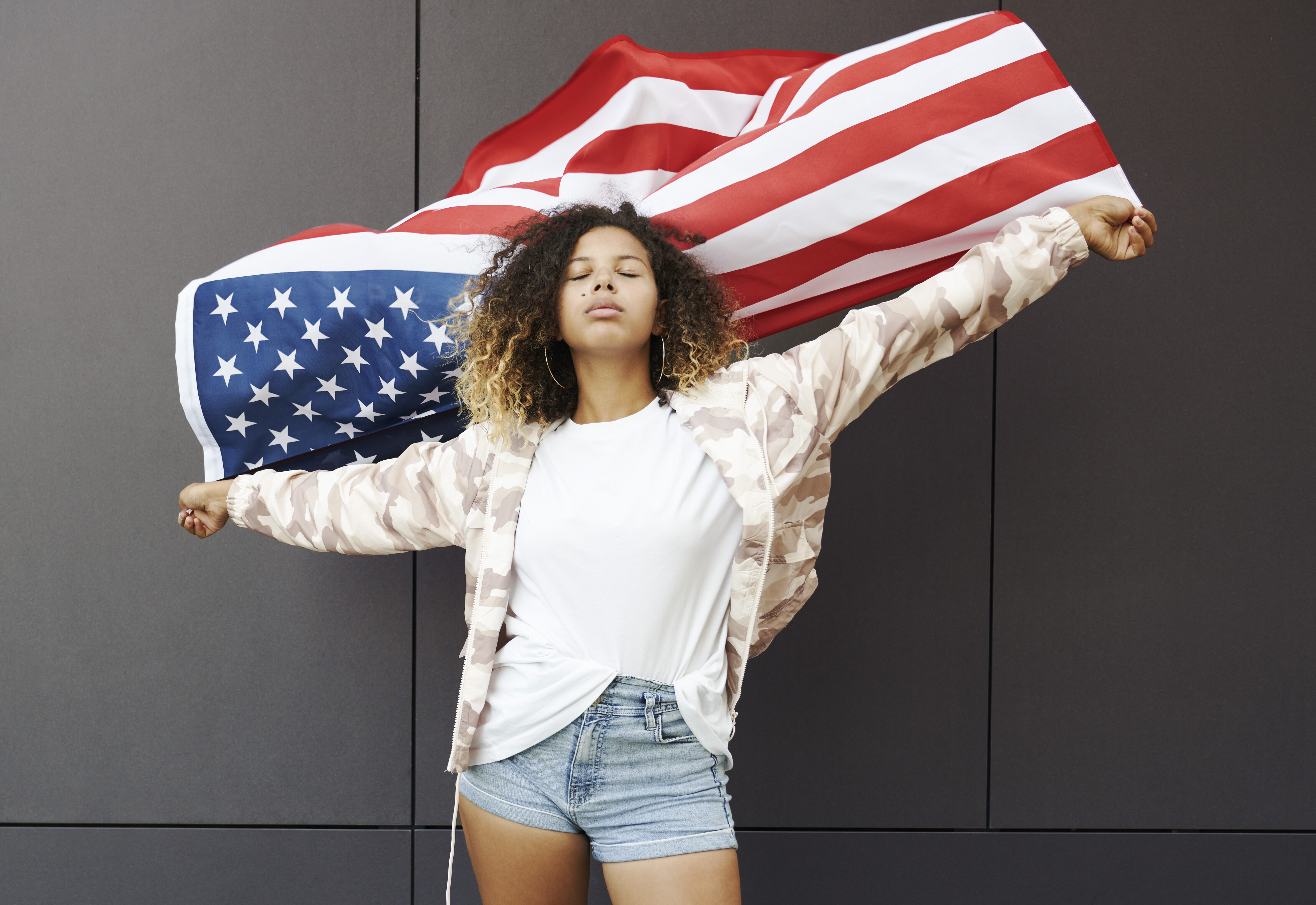 proud-woman-holding-american-flag