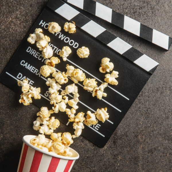 sweet-popcorn-in-cup-and-clappeboard