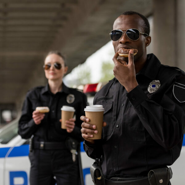 young-police-officers-having-coffee-break-with-donuts