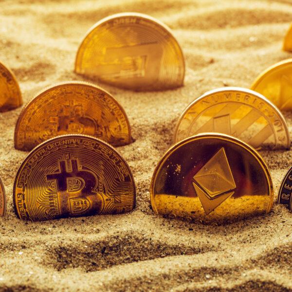 blockchain-coins-in-sand