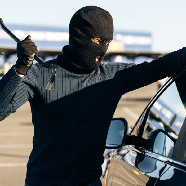 man-dressed-in-black-with-a-balaclava-on-his-head-looting