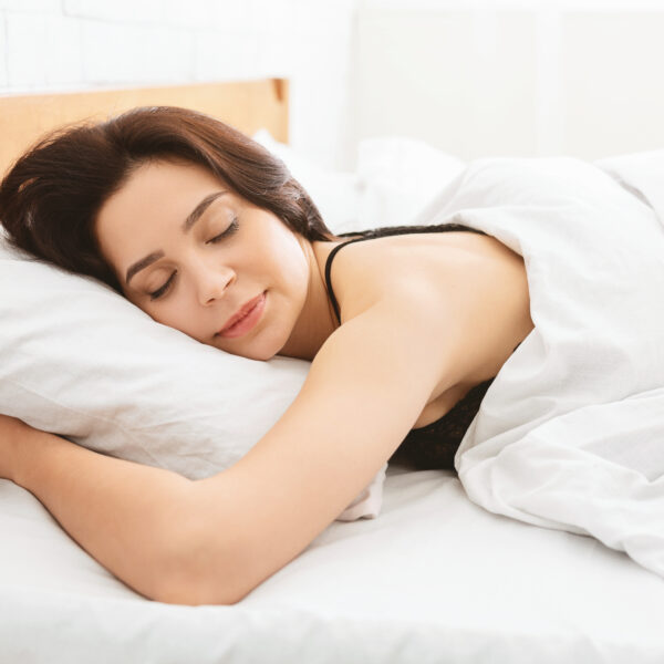 young-woman-sleeping-in-bed-close-up-comfort