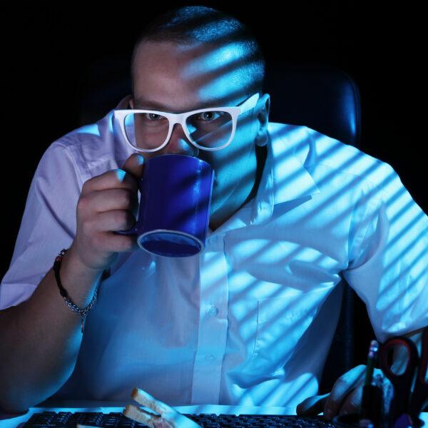 nerd-surfing-internet-at-night-time-